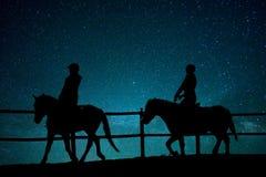 Paardrijden in het heelal stock afbeelding