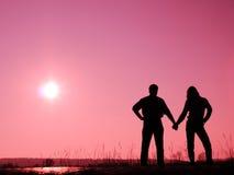 Paare auf der Sonne Lizenzfreie Stockbilder