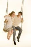 Paare auf einem Schwingen Stockfotografie