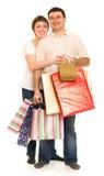 Paare bemannen und Frau mit Einkaufstasche lizenzfreies stockfoto