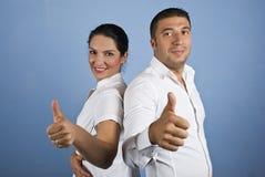 Paare der Geschäftsleute, die Daumen aufgeben Lizenzfreies Stockbild