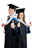 Paare der glücklichen Studenten im Aufbaustudium lizenzfreie stockbilder