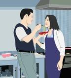 Paare in der Küche. Stockbild