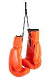 Paare der orange Verpackenhandschuhe Lizenzfreie Stockbilder