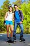 Paare der Rollen-Schlittschuhläufer Stockbild