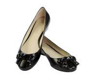 Paare der schwarzen flachen Schuhe Stockfotos