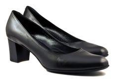 Paare der schwarzen Schuhe stockbild