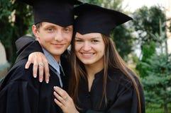 Paare des glücklichen Absolvent Lizenzfreies Stockfoto