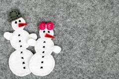 Paare des Schneemannes Stockfoto