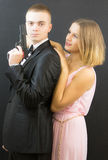 Paare, die in der Geheimagentart aufwerfen Lizenzfreies Stockfoto