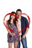 Paare, die ein Herz mit Aerosoldose zeichnen Lizenzfreies Stockbild