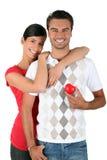 Paare, die ein Inneres anhalten Stockbilder