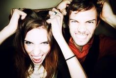 Paare, die heraus ihr Haar zerreißen Lizenzfreies Stockbild