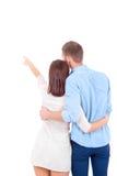 Paare, die irgendwo schauen und diese Richtung zeigen Lizenzfreies Stockfoto
