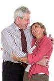 Paare, die sich umarmen Lizenzfreie Stockfotos