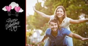 Paare, die vortäuschen, in Park zu fliegen Stockbild