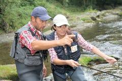 Paare an einem Fischereitag Stockfoto