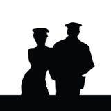 Paare im Polizeiuniformschattenbild Stockbilder