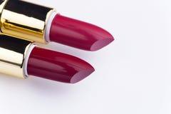 Paare Lippenstift auf weißem Hintergrund Lizenzfreie Stockfotos