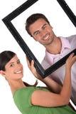 Paare mit einem Bilderrahmen Stockfoto