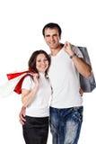 Paare mit Einkaufenbeuteln Stockbilder