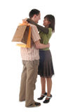 Paare mit Einkaufenbeuteln Lizenzfreie Stockfotos