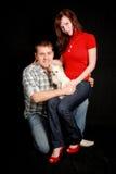 Paare mit Hund. Lizenzfreie Stockfotos