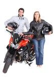 Paare mit Motorrad Lizenzfreie Stockfotos