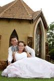 Paare sitzen   Lizenzfreie Stockbilder