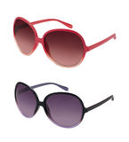 Paare Sonnenbrillen in den verschiedenen Farben Lizenzfreie Stockbilder
