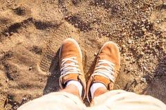 Paare Stiefel auf Sand Stockfoto