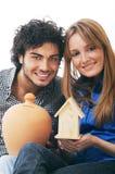 Paare und moneybox Lizenzfreies Stockbild