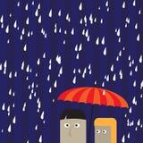 Paare unter einem Regenschirm stockfoto