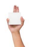 Paare von Fingern mit dem gemalten smiley, der Anmerkung hält Lizenzfreie Stockbilder