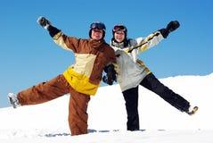 Paare von Snowboarders Lizenzfreie Stockfotos