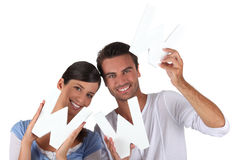 Paare, welche die Zeichen WWW anhalten Lizenzfreies Stockfoto