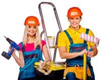 Paarerbauer mit Bauwerkzeugen Stockbilder