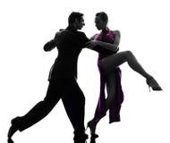 Paarman de dansers die van de vrouwenbalzaal silhouet tangoing Stock Afbeeldingen