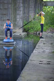 Professionelles sportliches Training des Mannes und der Frau im Freien Lizenzfreie Stockfotografie