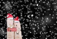 Paarvinger en gift op de abstracte achtergrond van de Kerstmisvakantie Stock Afbeeldingen