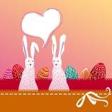 Paashaaspaar met geschilderde eieren Stock Afbeeldingen