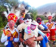 Pablitos and Chunchos in procession in the Sacred Valley. Dancers at the Virgen de la Natividad religious festival in the district of Huayllabamba, Cusco royalty free stock photos