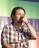 Pablo iglesias gesturing during meeting. Podemos We Can party leader Pablo Iglesias, one of the leading candidates for Spain`s national election, gestures during Stock Photography