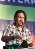 Pablo iglesias during meeting. Podemos We Can party leader Pablo Iglesias, one of the leading candidates for Spain`s national election, gestures during a Royalty Free Stock Image