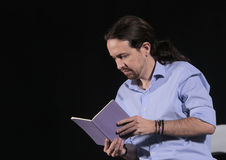 Pablo iglesias 012. Podemos (We Can) party leader Pablo Iglesias, one of the leading candidates for Spain's national election, read his notes during a campaign Royalty Free Stock Images