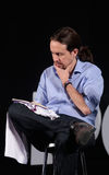 Pablo iglesias reading notes at campaign rally. Podemos (We Can) party leader Pablo Iglesias, one of the leading candidates for Spain's national election Stock Photography