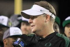 PAC-12 Championship Game - Coach Kelly. Oregon Ducks' coach Chip Kelly conducts an on-the-field interview after his teams victory in the inaugural PAC-12 Royalty Free Stock Images