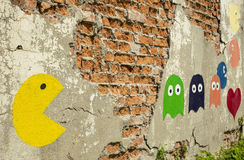 Pac-man graffiti. Old arcade game, painted on a wall Royalty Free Stock Photography