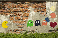 Pac-man graffiti. Old arcade game, painted on a wall Royalty Free Stock Photo