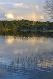 Rainbow over the lagoon Pac chen, Quintana Roo. Perfect spot for camping in Pacchen´s lagoon, Yucatan. The unexpected rainbow created a beautiful scene while Stock Image